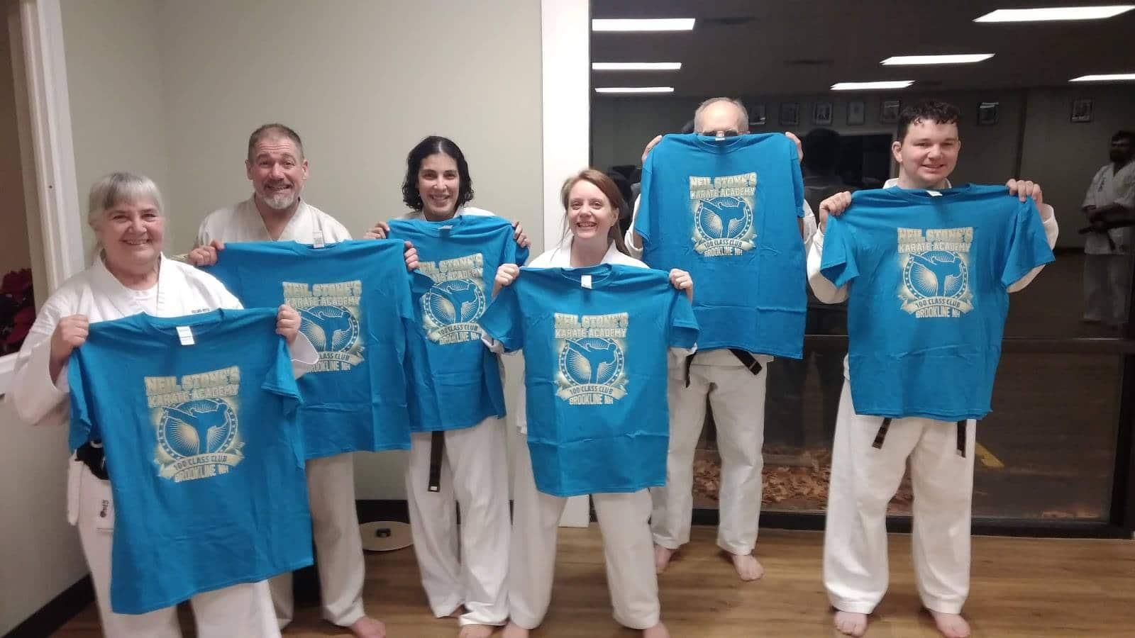 Neil Stone Karate Students getting 100 class Tshirts