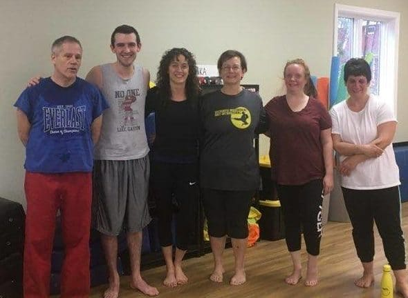 Neil Stone's Karate Academy Program Manager Deb Stone with fellow martial artists