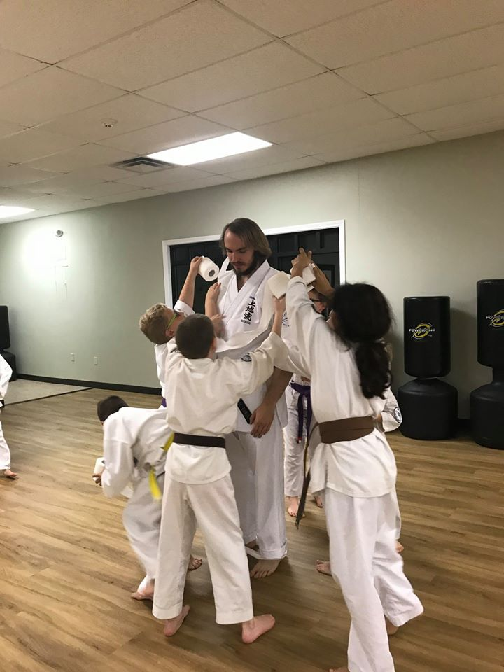Instructor John Smith interacting with Students at Neil Stone's Karate Academy