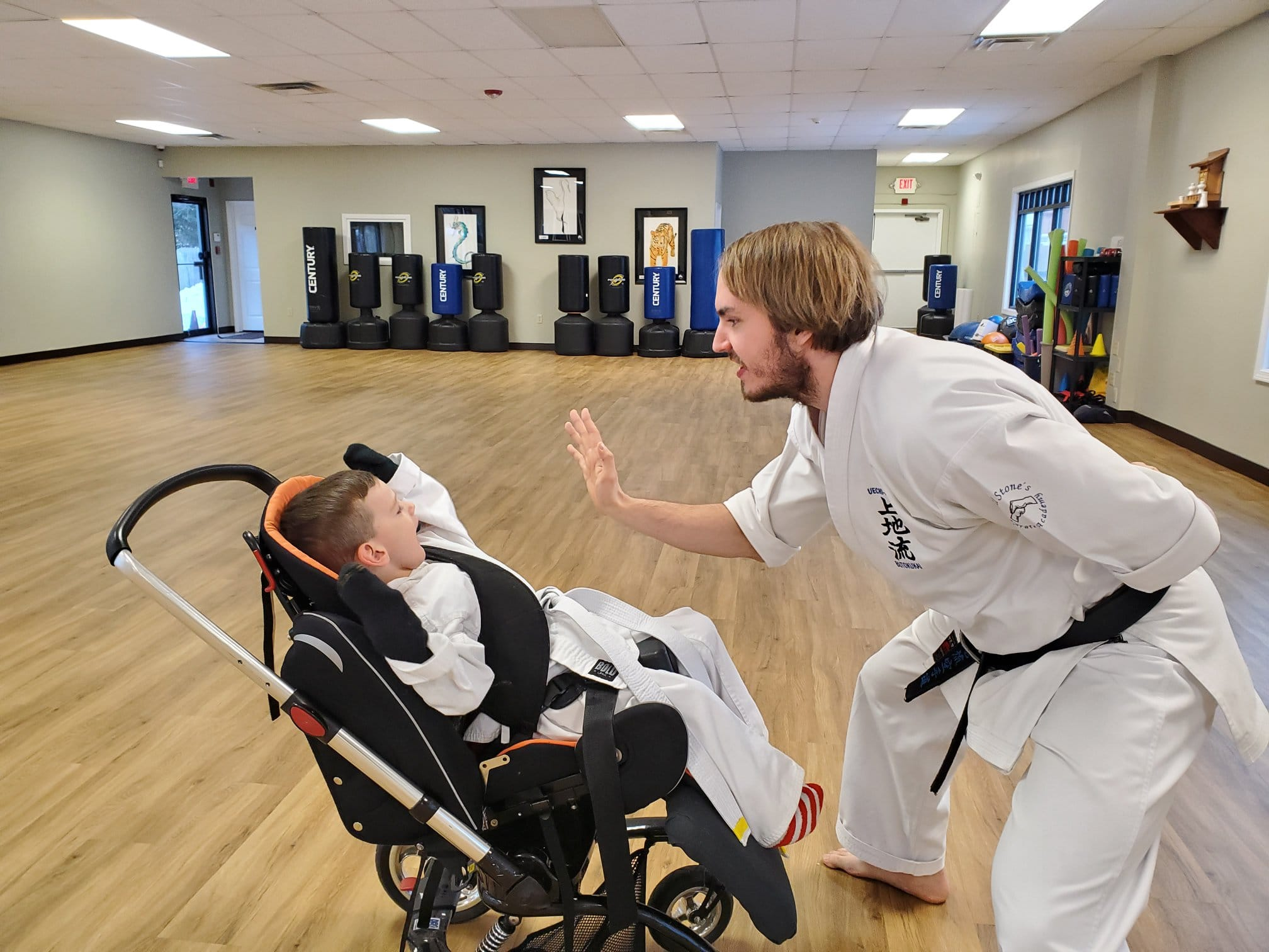 Head Instructor John Smith High-Fiving a student
