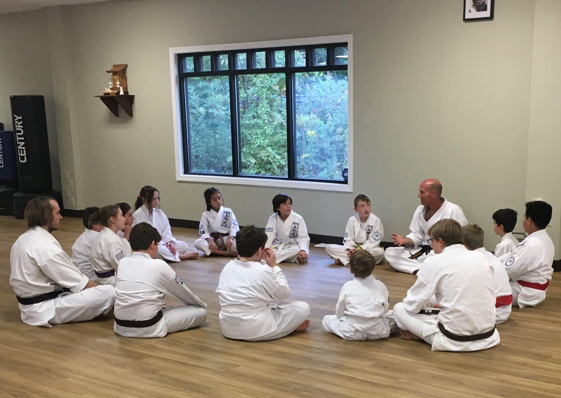 Sensei Neil Stone Mentoring a group of students