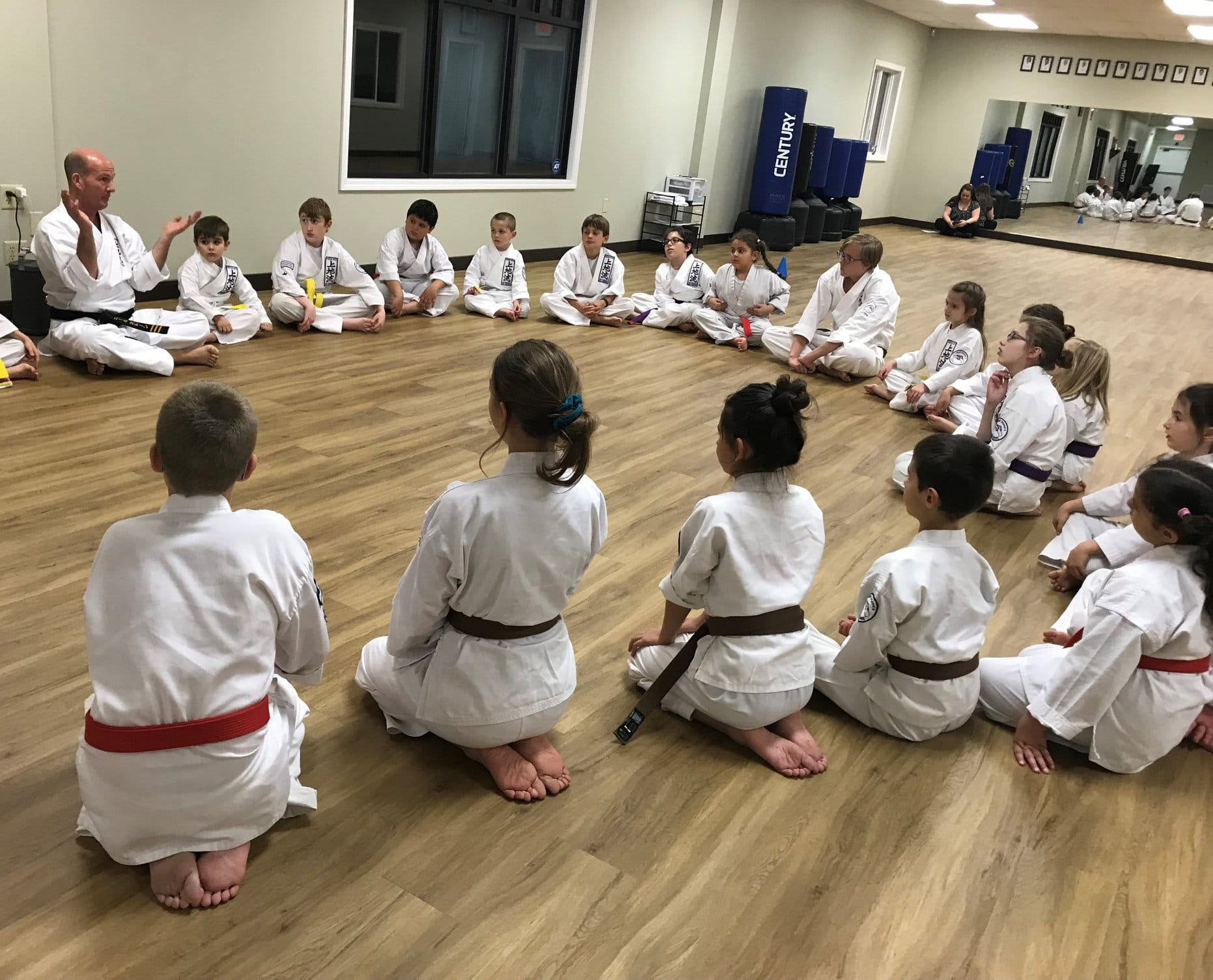 Kids sitting in a circle at Neil Stone's Karate Academy